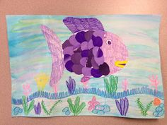 Great lesson on tints and shades and making use of kid's painting to make Rainbow Fish!