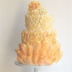 What do you think of this peachy-keen wedding cake? We love this shade of orange!   Peach Petals Cake // The Knot Blog