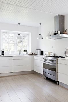 modern white Scandinavian kitchen. With a butcher block for and island