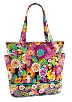I carry this tote to work!  Love it.  There are 4 pockets all around the outside and 3 smaller slip pockets inside.    Go Round Tote | Vera Bradley - Va Va Bloom!