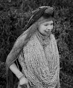 Tribal women in mourning from Papua New Guinea (PNG). The Mindima widow's will remove one collar of seeds each day of the mourning time, until the last one. Then she can wash herself and find a new husband. Papua New Guinea 1983, photo by Jeff Shea.