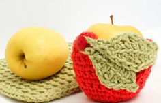 I worked up this fun apple crochet cozy ... not only are these cute to use but they do help keep apples from getting bruised while bouncing around in backpacks, lunchboxes, and briefcases.