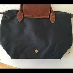 small navy longchamp bag please disregard blacks specs in photos my camera is defected. I can assure you there are no black specks on this item. authentic. shows sign of use. price reflects ware especially to the outer corners of the bag Longchamp Bags