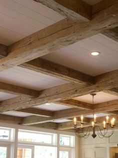 ceiling grid of rustic beams - Giannetti Architects