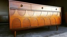 Mid Century Modern 9 drawer piece. Walnut top and in prestine condition. Very unique design. Shipping is not included in price. Please send zip code for accurate quote. Price for shipping is just an estimate.
