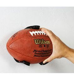 Use the Ball Claw Wall Mount Football Holder to display your sports memorabilia or simply to hold your footballs in your garage until the next game. Love this!