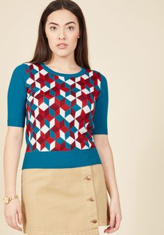 <p>Listen up, because this teal sweater is projecting a message you won't want to miss! A geometric motif in white, crimson, and burgundy tones accompanies the half sleeves and slightly cropped silhouette of this lightweight top, which come together to speak nothing but praises for your stylish behalf. Sounds good to us!</p>