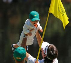 Bubba had his sons outfit custom made.  So cute!  Watson lifted his son Caleb in the air.