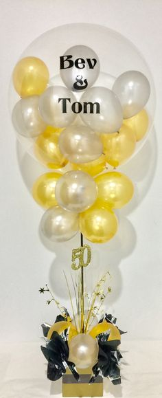 50th wedding anniversary balloon decoration in elegant gold and silver. Custom deco bubble.