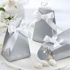 Express Your Love Elegant Icon Favor Boxes quickly assemble for you to fill with a delightful desserts and candy to thank guests for sharing your day.