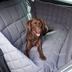 Car Seat Cover - protects the entire length of the back seat and the door…