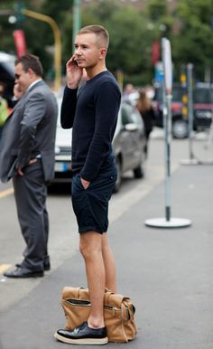 I kind of like the long sleeves w/shorts and no socks thing, but not the monochromatic look thing... or the shoes. Via The Sartorialist.