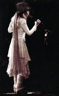 Stevie NicksGreat shot of Stevie, it really shows how small and tiny she is.  A lot of power, talent and personality in that little package⭐️❣⭐️