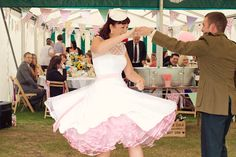 Rockin the short vintage style wedding dress with colorful petticoat -- so adorable.