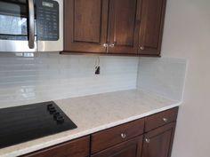 kitchen with subway tile backsplash and oak cabinets - google