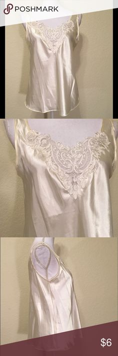"""NWOT Ivory Satin & Lace Camisole NWOT Ivory Satin & Lace Camisole.  Size M.  Brand is Enchanting.  Lace bodice detailing.  Length shoulder to hem: 25"""".  Pit to pit: 20"""".  Bottom of camisole: about 42"""" around.  100% polyester.  Machine wash cold, tumble dry low.   Love it but not the price - I'm open to (reasonable) offers or consider bundling 2 or more items for an additional 15% off and combined shipping! Enchanting Tops Camisoles"""