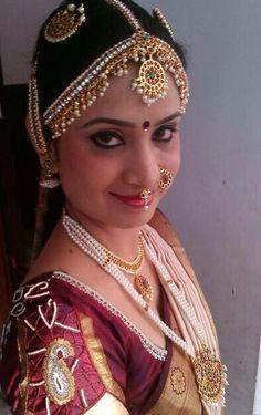 Traditional South Indian bride wearing bridal saree and jewellery. Muhurat look. Makeup by Swank Studio. Find us at https://www.facebook.com/SwankStudioBangalore