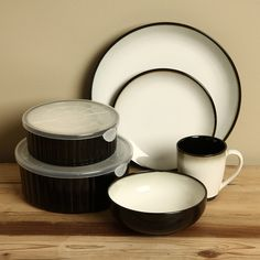 Add a rustic touch to your dinner table with this handcrafted Sango dinnerware set. This set features a black and white glazed design with a white center. & Overstock.com - Sango Nova Black 5-piece Dinnerware Completer Set ...