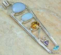 Items similar to Fire Opal, Citrine, Blue Topaz, Amethyst Sterling Silver Pendant - weight - dim 3 x 1 x inch - code on Etsy Opal, Amethyst, October Birth Stone, Sterling Silver Pendants, Blue Topaz, Gemstone Rings, Gemstones, Unique Jewelry, Handmade Gifts