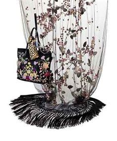 A BLACK SATIN EVENING TOTE BAG, A BLACK TULLE AND MULTI-COLORED SILK STOLE AND A PAIR OF SUNGLASSES  LABELED 'VALENTINO GARAVANI', PROBABLY LATE 1990S-2000S   the bag with fuchsia, lilac and yellow embroidered and applied silk flowers, with black lizard handles, underside and red lizard interior pocket; the stole embroidered and applied with silk flowers, with silver metal thread and diamanté embellishments; the sunglasses wayfarer style, with clear lenses and with leopard print case (3) Red Lizard, Valentino Garavani, 2000s, Black Satin, Silk Flowers, Lilac, Tulle, Elizabeth Taylor, Tote Bag