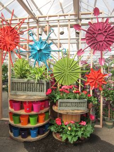 Beauty Blooms. Flowers constructed from garden tools. Visual merchandising. VM. Retail store display. Garden, greenhouse. Plants.