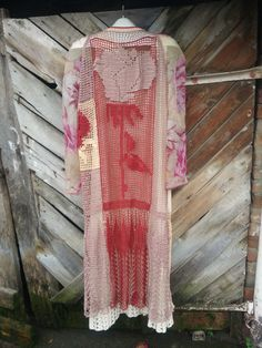 The dress of cotton yarn and crochet needles in the technique of free knitting.