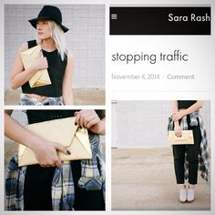 SONA GOLD LAMB & SILK  CLUTCH.                        @saralrash gives a unique twist to one of our classics by pairing it with a plaid duster! We LOVE it! #Sona #gold #lamb #leather #envelope #plaid #cool #fashion #bloggers #armcandy #streetstyle #downtown #islyhandbags @sararash