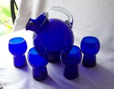 For your consideration is a blue cobalt pitcher and four matching tumblers. They were made by the Cambridge Glass Company in the 1940's and 50's. The