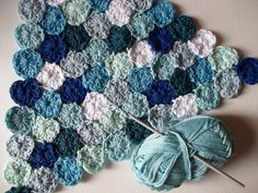 Sea Pennies ~ crochet project of Magic Circles done JAYG (*lots of ends to weave in), so can be made for any size/shape ~ love this blue coastal palette! | by Julia Crossland via Blogspot | also archived at http://web.archive.org/web/20120610025146/http://www.juliacrosslandart.com/2011/02/how-to-crochet-sea-pennies.html