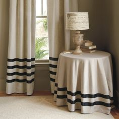 Like this look.  I'd buy inexpensive white or ivory curtains and DIY the stripes with some grossgrain ribbon.