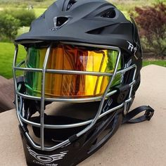 SHOC Iridium Insert in and Oakley Visor installed into a Lacrosse Cascade R Matte Black Helmet. Excited to supply equipment to America's Fastest Growing Game! www.shocvisor.com