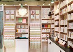 High shelves for candles. via Oh So Beautiful Paper: National Stationery Show Part 8 / Belle & Union Stationary Shop, Stationery Store, Gift Shop Interiors, Booth, Paper Store, Boutique Decor, Store Displays, Retail Shop, Retail Design