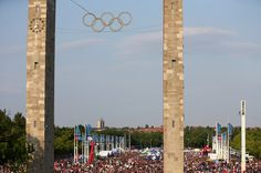 A general view showing the Olympic rings as fans gather outside the stadium prior to the UEFA Champions League Final between Juventus and FC Barcelona at Olympiastadion on June 6, 2015 in Berlin, Germany.