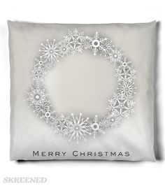 KRW Gorgeous Snowflake Wreath Merry Christmas Pillow | This lovely snowflake wreath pillow will become the centerpiece of your holiday decorating. Neutral shades of silver, gray and white will enhance any decor. #Skreened