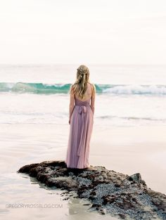 These Laguna Beach engagement photos capture the scene beautifully! The groom leads his bride to-be, who's wearing a beautiful lavender gown, from rock to rock, spinning, and carrying her along the way.