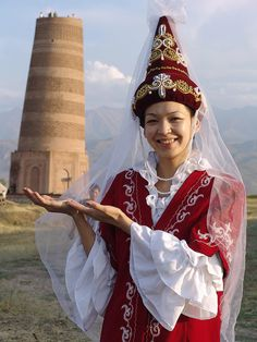 A Kyrgyz woman in her traditional dress I feel an intense longing for these plains surrounded by mountains. Kyrgyzstan