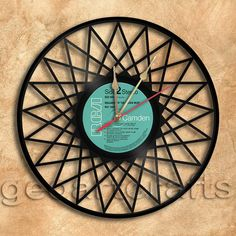 Wall Clock Stars Vinyl Record Clock Upcycled Gift by geoartcrafts Vinyl Record Clock, Vinyl Records, Record Crafts, Cool Clocks, Diy Clock, Rock T Shirts, Crafts To Make, Upcycle, Unique Gifts