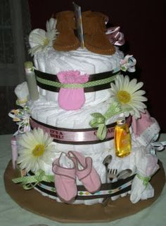 How To: Make a Diaper Cake. Instead of rolling 84+ diapers with a rubber band and knowing that the mother of a newborn does not have time to unwrap all of those diapers, I came up with a different way, much easier to make and dismantle and still, Oh, so cute!
