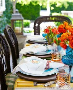 Brightly colored table complements the bright flavors of the menu at a backyard fiesta. - Traditional Home ® / Photo: Luca Trovato