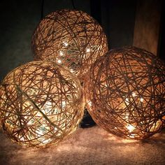TWINE SPHERES - DIY ... as you c an see through them, i would definitely use lights with white cords or sand-colored cords ... muchocrafts
