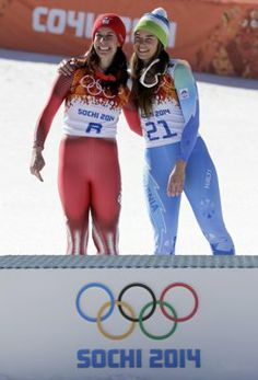 Dominique Gisin and Tina Maze stand on the podium after tying in the women's downhill. Tina Maze, Youth Olympic Games, Winter Olympics, Tie, History, Sports, Fashion, Winter Olympic Games, Moda