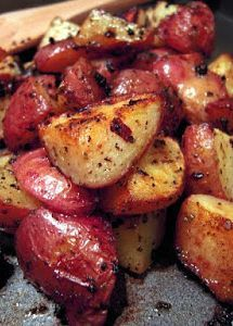 Roasted Greek Potatoes - toss red potatoes in Greek seasoning and bake - super easy side dish that tastes delicious!