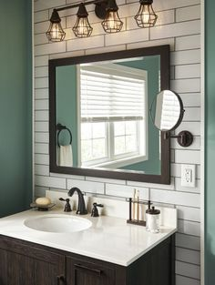 Create depth in your bathroom with wall tile. A white subway tile wall provides a distinctive vanity space, further highlighted by an industrial light fixture. Start your bathroom reno with Lowe's by clicking this pin!
