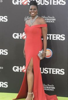 Leslie Jones rocked an off-the-shoulder, bright red gown designed by Christian Siriano at the premiere of 'Ghostbusters' — see the pics!