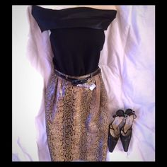 """VALENTINO Python Skirt Classic Valentino python/leather straight skirt. Italian made, size 40, belt loops, hidden side zipper with button. Brown, tan, beige, green hues. This is a one of a kind piece, art fashion. Please use the measurements for sizing. W 25"""" H 36"""" Length 23"""" 1/2"""". From my closet to yours! Valentino Skirts Pencil"""