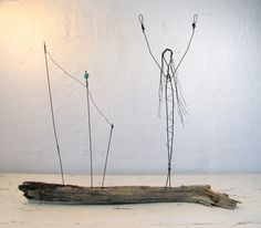 Wire Sculpture Celebrate Life Mixed Media Sculpture by idestudiet. $64.95, via Etsy.