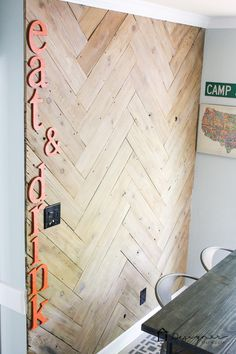 OMG! This DIY plank wall in a herringbone plank wall is AWESOME. Love that the blogger upcycled it from an old, ugly fence that she tore down!