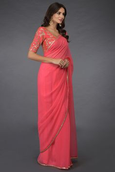 From our sheer glamour collection, this is a pink sequin hand embroidered pure chiffon saree paired with tagai and floral sequin hand embroidered blouse. The blouse is crafted in pure silk and underlined with cotton shantoon. The saree is finely Saree Styles, Blouse Styles, Mirror Work Saree, Chiffon Saree, Cotton Saree, Kalamkari Dresses, Saree Wearing, Long Gown Dress, Silk Saree Blouse Designs
