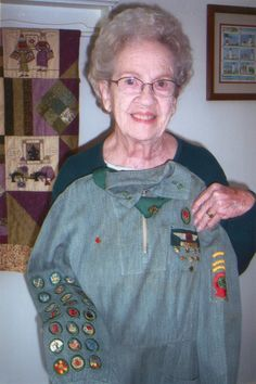 """Girl Scouts at 100: Still 'courageous and strong' - The Orange County Register.  """"When I was 10 I joined the Girl Scouts in Medfield Mass. in 1938.  The most exciting of my Girl Scout moments was when I became a Wing Scout and each of us girls were given a short ride in a two-seater plane that the Norwood Airport.  Being up there, flying in the sky for the very first time was quite a thrill for me.""""  Audrey R. Coming, holding the uniform she wore in 1946,"""