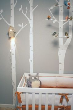 What a whimsical owl and birch forest themed nursery with the birdhouse nightlight and the sweet bird mobile. #nurseryideas #forestnursery #birdnursery